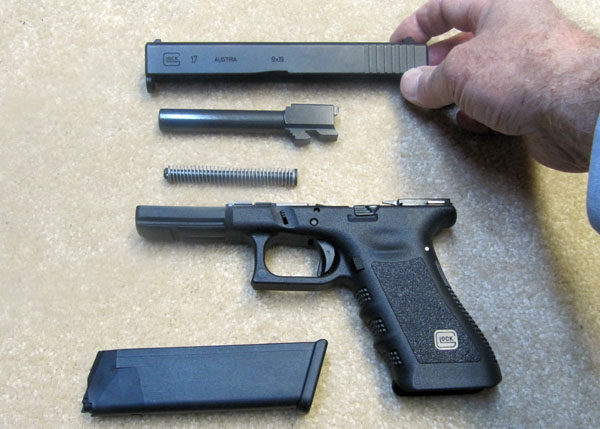 Glock 17 Disassembled for Cleaning, Frame, Recoil Spring, Barrel, Slide